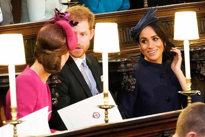 kate middleton and meghan markle s reaction to princess eugenie s wedding dress marie claire australia kate middleton and meghan markle s